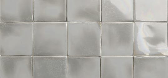 Iridescent warm grey glazed tiles